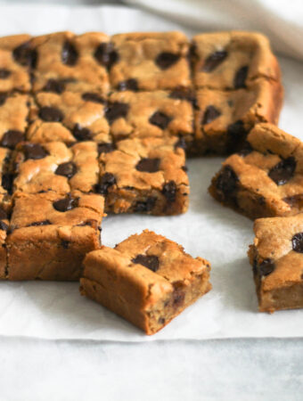 Peanut butter chocolate chip chickpea blondies cut into squares