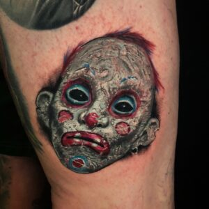Best Color Clown mask tattoo in Los Angeles Kyle DeVries