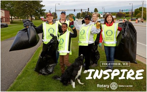 Rotary Club Members Clean Area of Road
