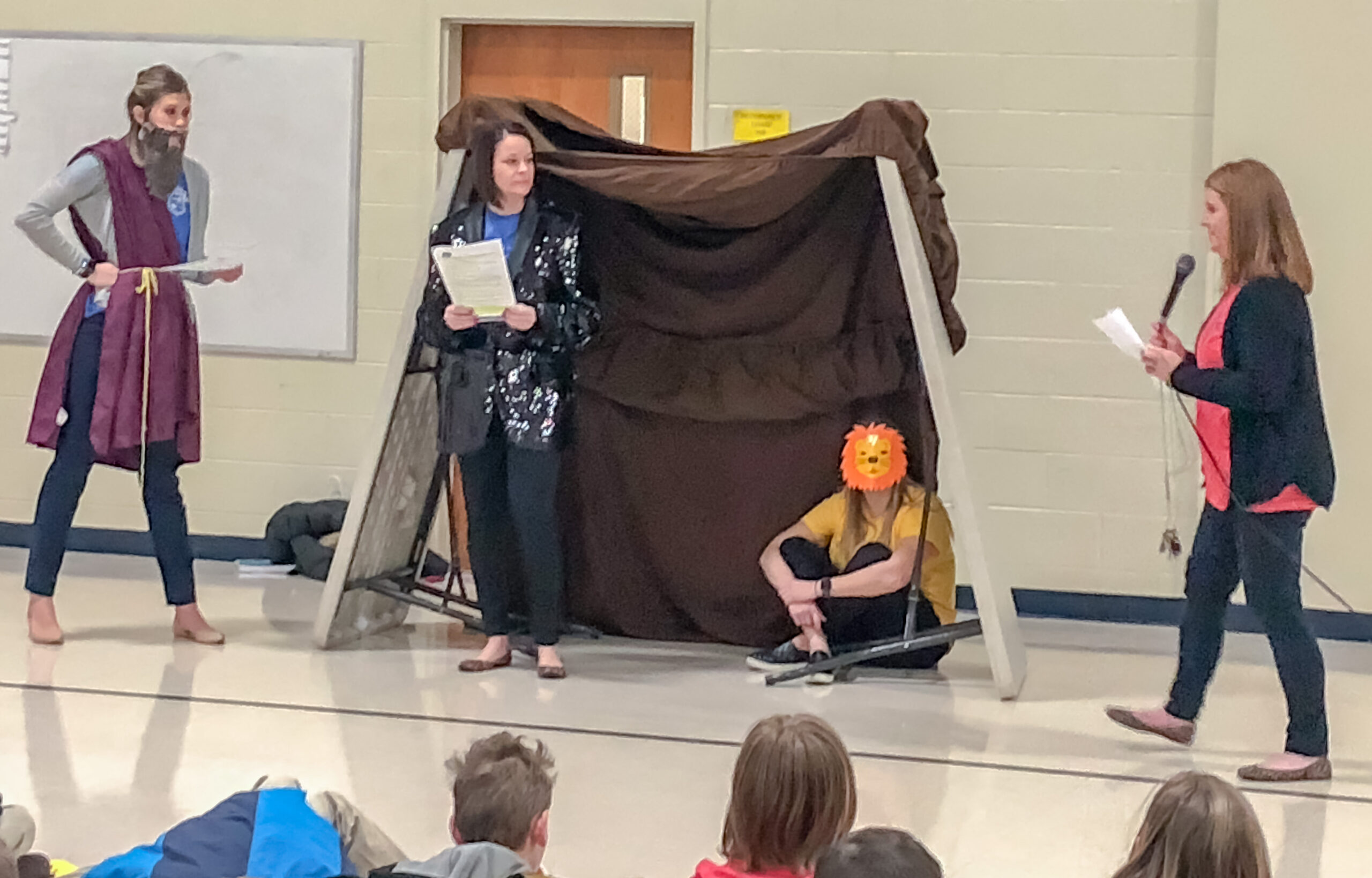 Wonderful learning experiences highlighted Catholic Schools Week at Corpus Christi School in Evansville. Among them were daily skits by the teachers that were based on the day's scripture readings. In this photo, teachers Abby Coudret, Jackie McCormick, Audrey Folz and Dawn Bunner recreate the story of Daniel and the Lion's Den. Submitted photo