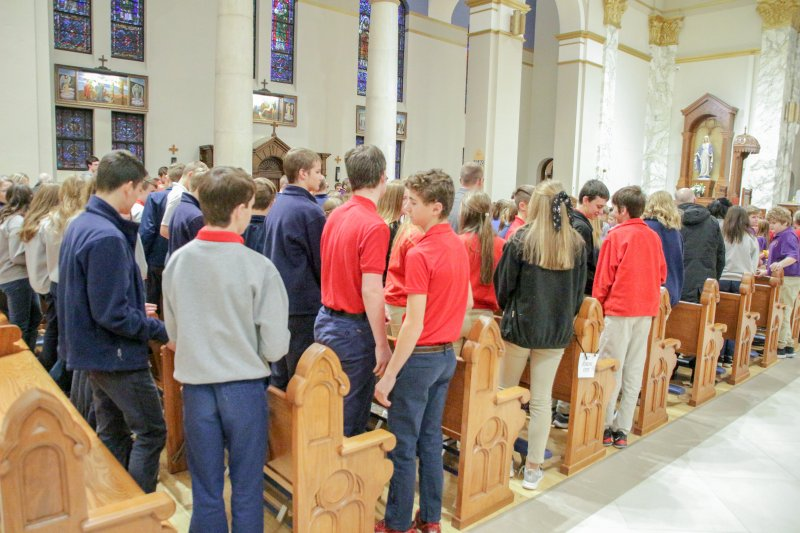 Students from across the diocese exchange signs of peace during the Mass. The Message photo by Tim Lilley