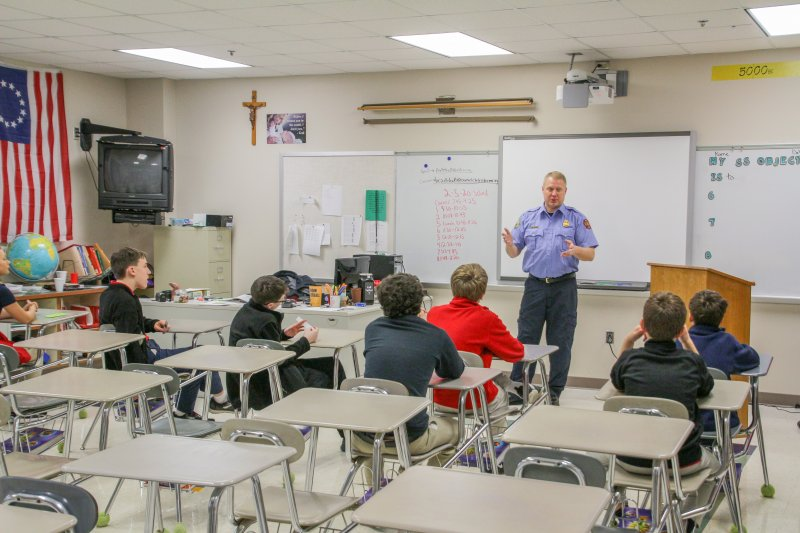 Evansville Fire Department Lt. Jon Laidlaw talks about the physical training firefighters go through as he visits with students during Holy Redeemer School's Feb. 5 career fair.