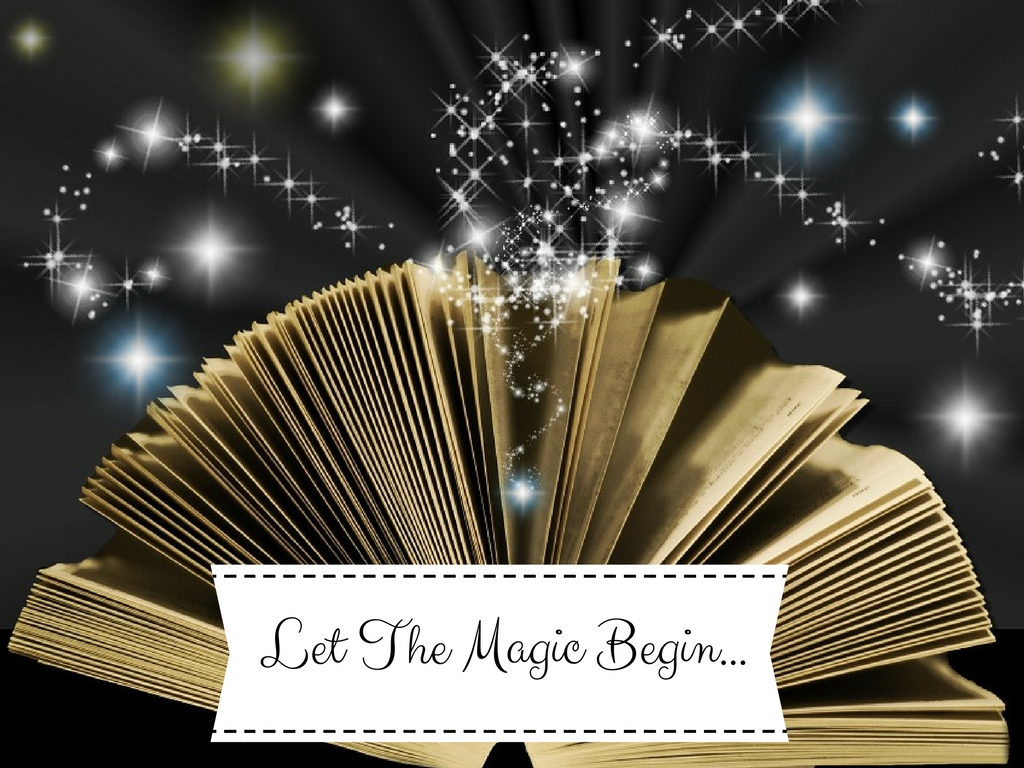 picture of an open book with magic dancing above it
