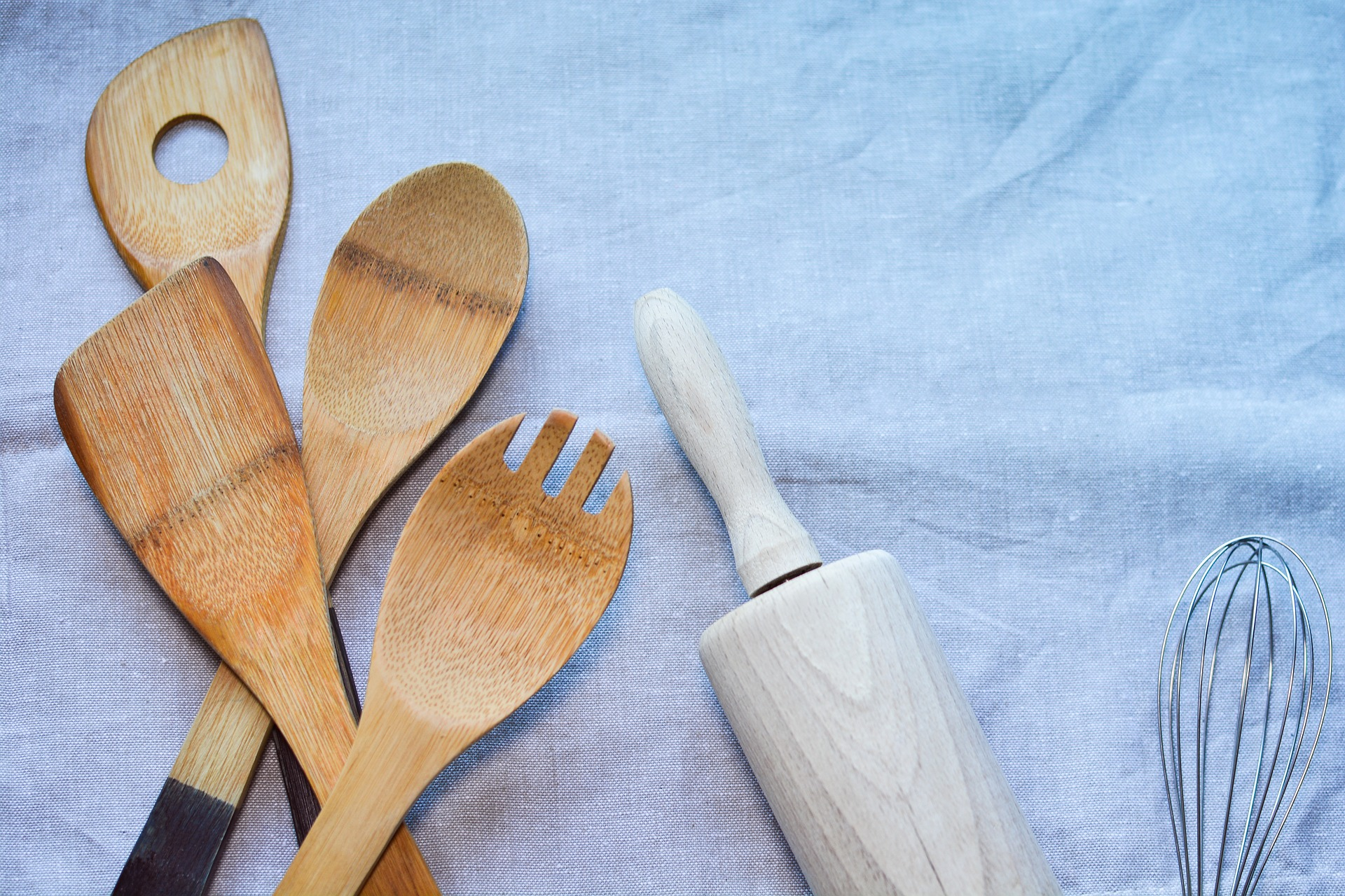 a collection of wooden kitchen utensils