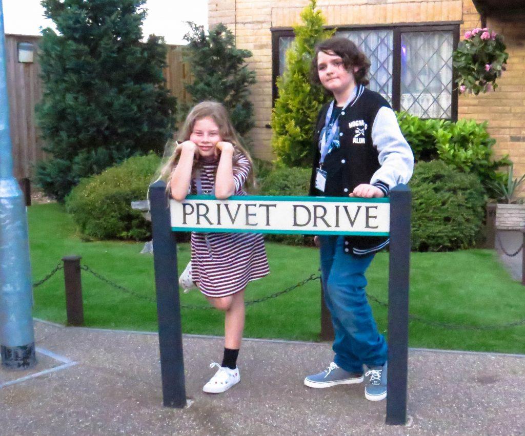 Rhiannon and Rowan standing outside privet drive