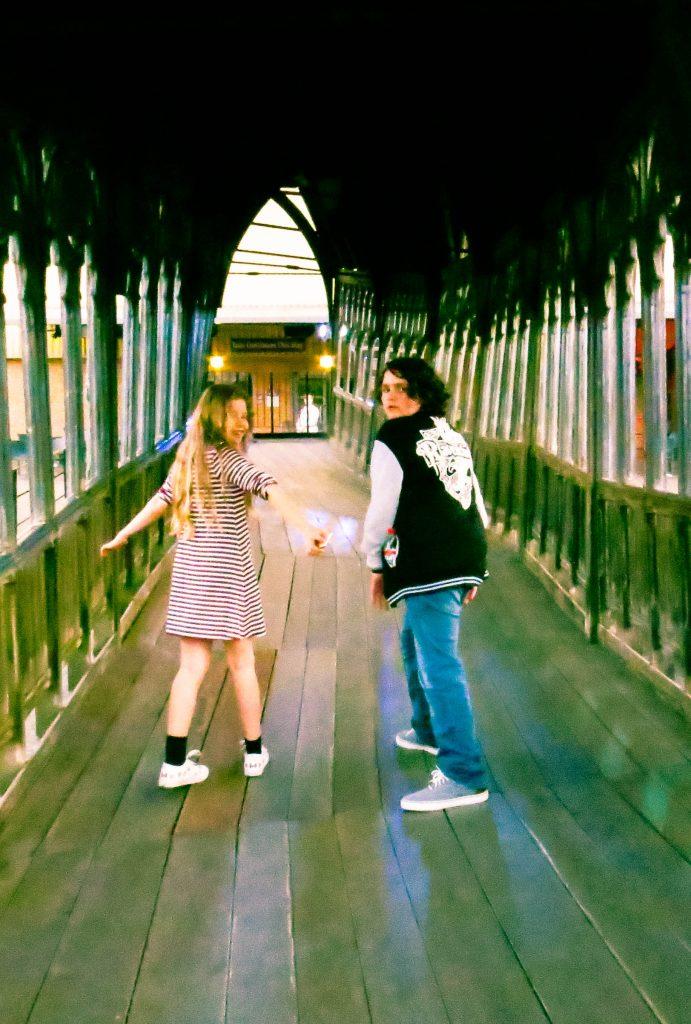 Rhiannon and Rowan running away down the Hogwarts Bridge