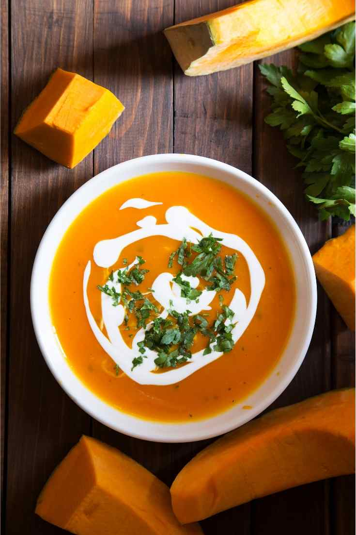 a bowl of butternut squash and chunks of raw squash