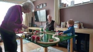 Playing with his great grandparents