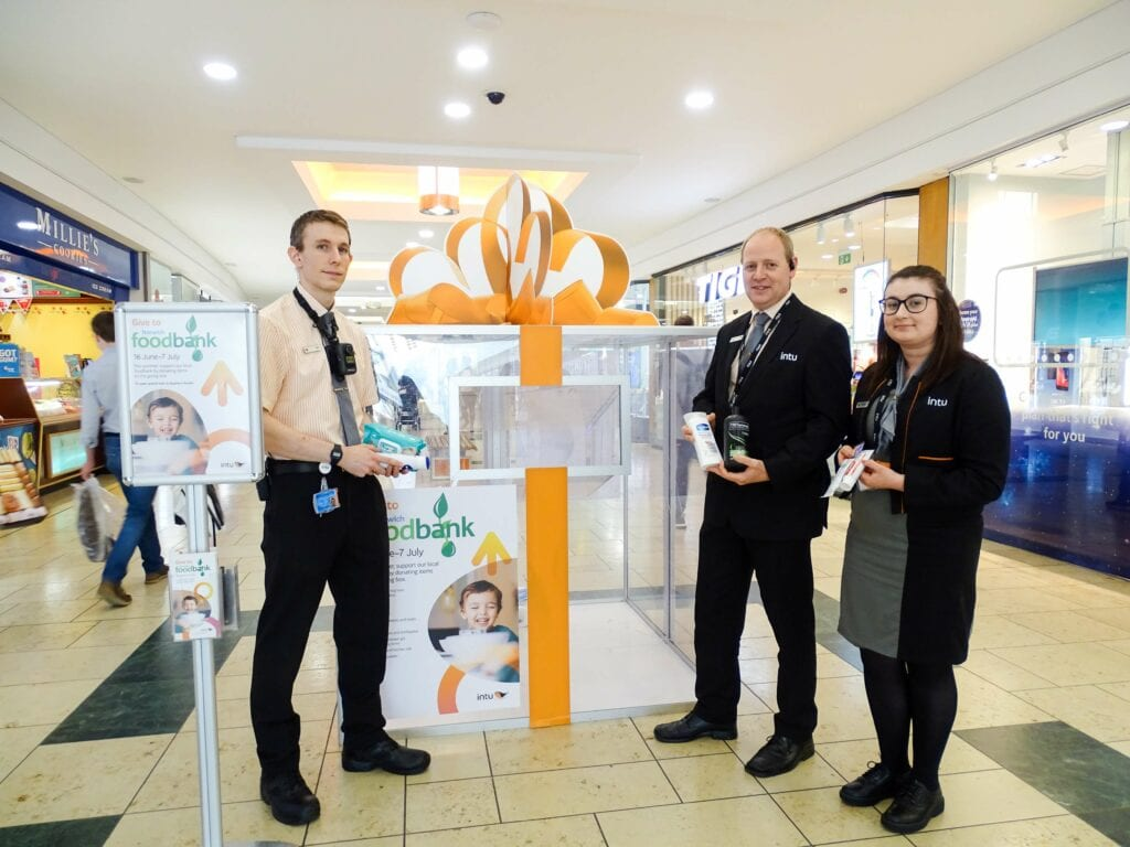 Press - Ryan, Paul and Hannah part of the intu Chapelfield team donate the first items to the Norwich Foodbank donation station in the shopping centre 16 June - 7 July 2019