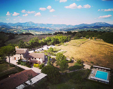 View from afar of the 17th century family villa in Umbria travel with kids to experience our family holidays