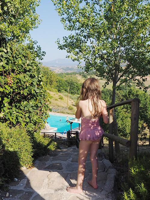 CHILD-AT-POOL ENJOYING A FAMILY HOLIDAY