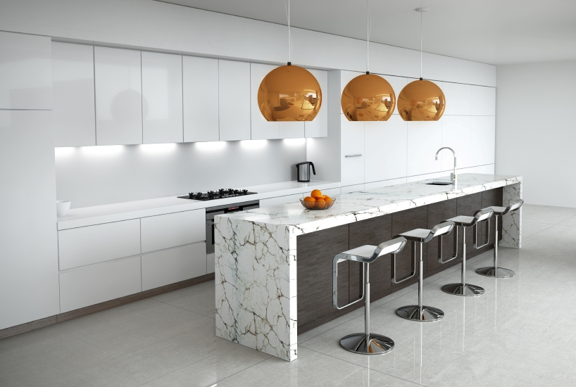 A luxurious white kitchen with chrome accents and a lengthy island in white marble with black veining