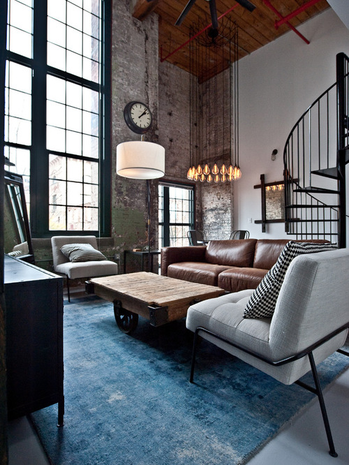 small-industrial-living-room-with-brown-leather-sofa-and-grey-single-sofa