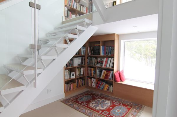 Stunning white bookcase under the stairs