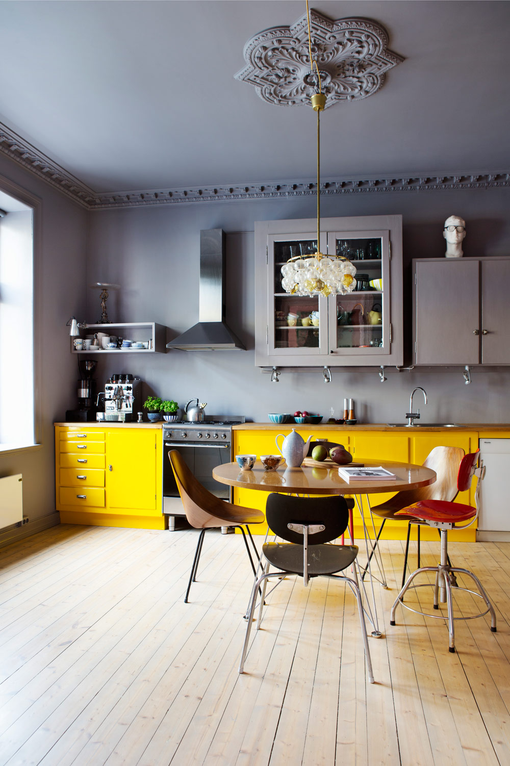 Colorful Kitchen With Yellow Cabinet Against Gray Walls