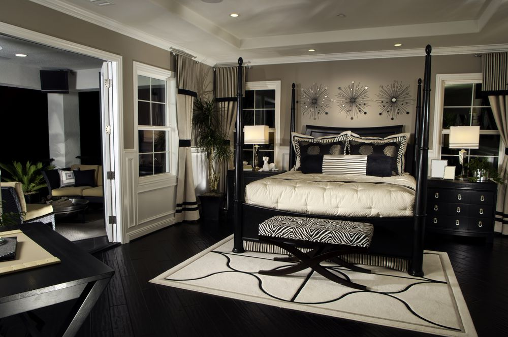 Eclectic Master Bedroom with French doors & Geometric area rug dwellingdecor