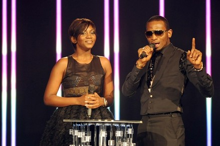 Nigerian singer D'Banj (R) and Nigerian actress Genevieve Nnaji present on December 11, 2010 the MTV Africa Music Awards ceremony in Lagos. The awards ceremony featured American rapper Rick Ross, as well as a host of top African artists including Fally Ipupa from the Democratic Republic of Congo, South Africa's Teargas and Kenya's P-Unit. AFP PHOTO / PIUS UTOMI EKPEI (Photo credit should read PIUS UTOMI EKPEI/AFP/Getty Images)