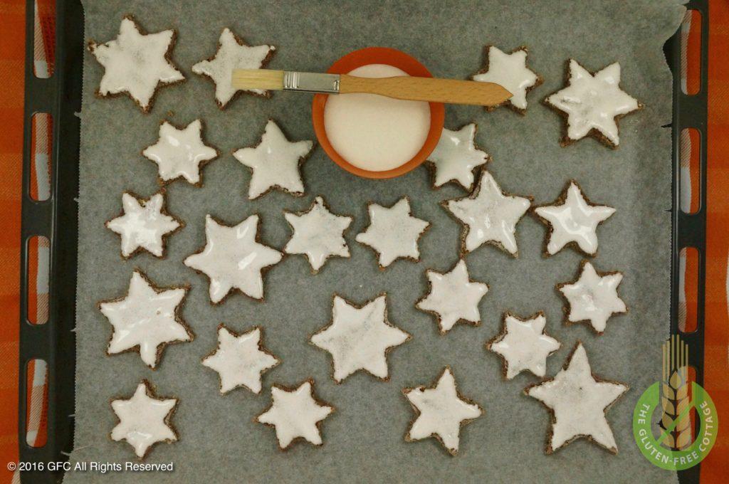 Spread egg white glaze on cookies (gluten-free cinnamon cookies).