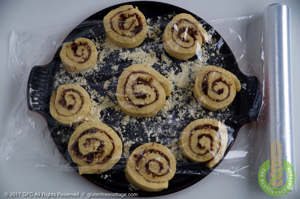 Slice dough roll into pieces and place on floured baking pan (gluten-free cinnamon rolls/ Danish).
