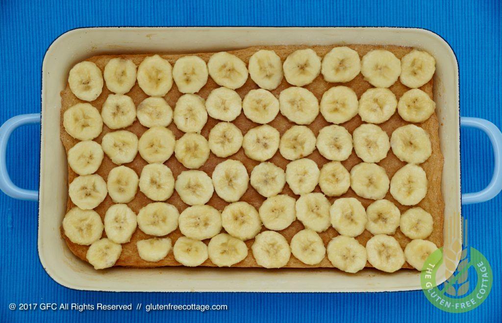 Banana slices spread over cake (gluten-free banana cake with chocolate glaze).