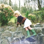 Alice rock climbing in frog boots