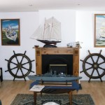 The Anchorage sitting area, nautical decor and paintings by owner