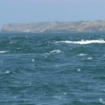 The Wildgoose tidal race north west of Skolkholm with Skomer in Looking north through Jack Sound from near Skolkholmthe background.