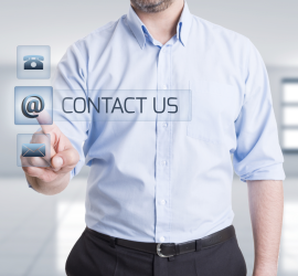 Contact us being written by a man on a transparent board