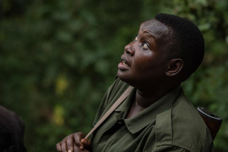 the-lost-chimps-kyambura-volcanoes-safaris-women-ranger