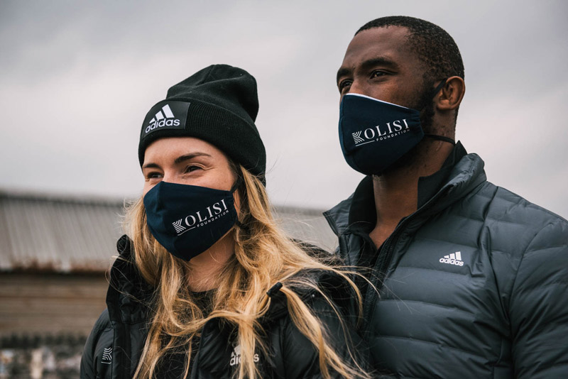 Rachel and her husband, South African rugby captain, Siya Kolisi wearing Kolisi Foundation masks.