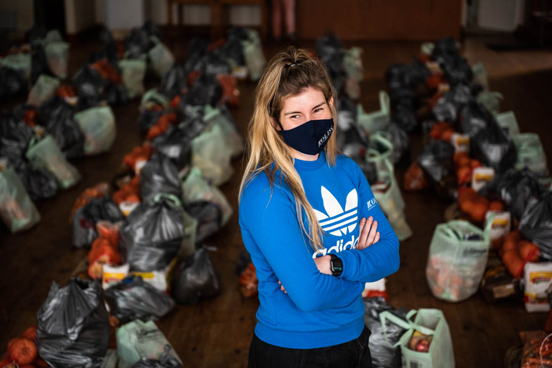 Rachel Kolisi with food parcel donated by the Kolisi Foundation.