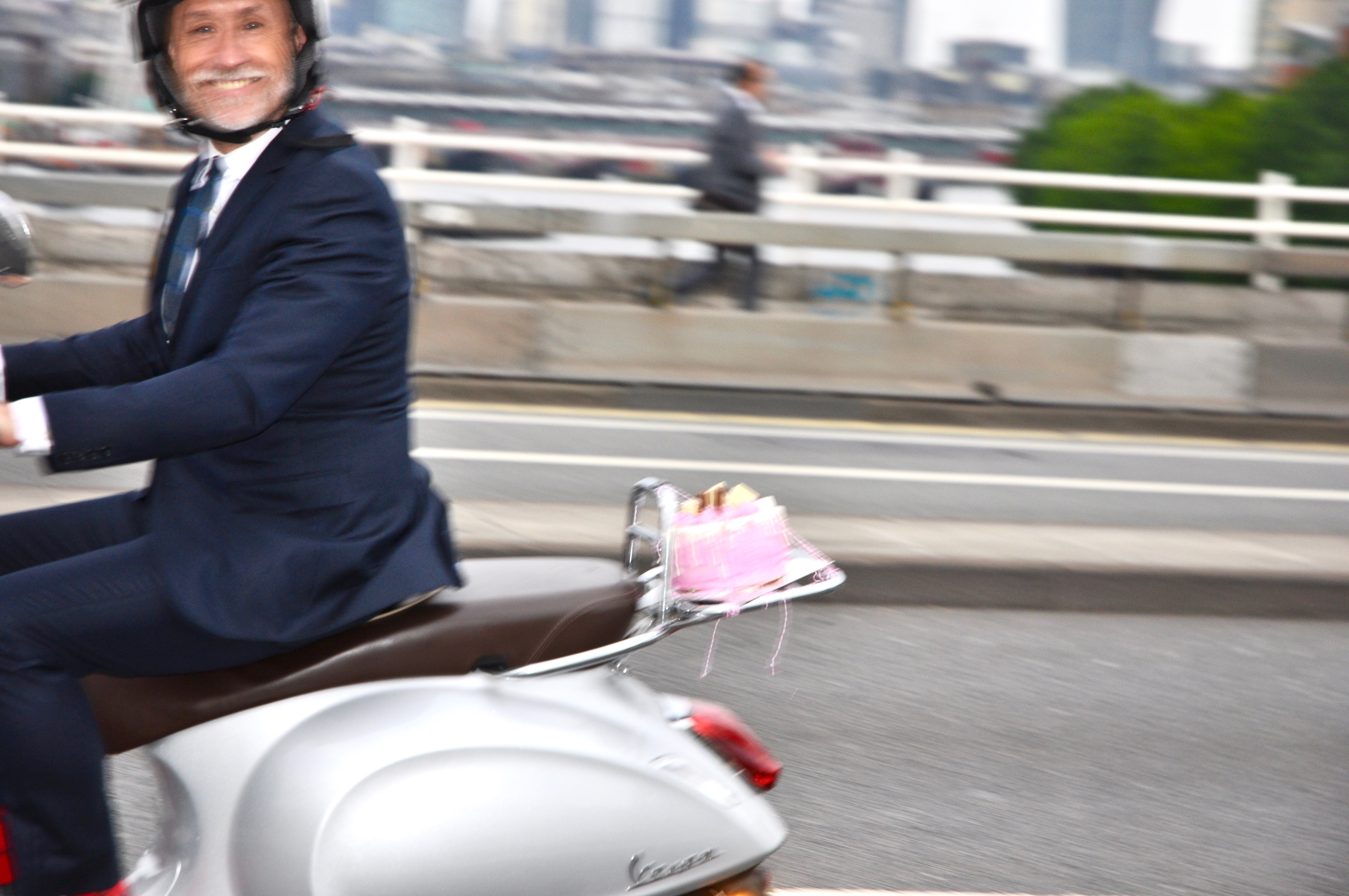 Richard Wilson on his scooter with CAKE