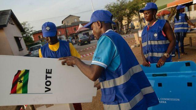 EC officials set up for voting to begin.