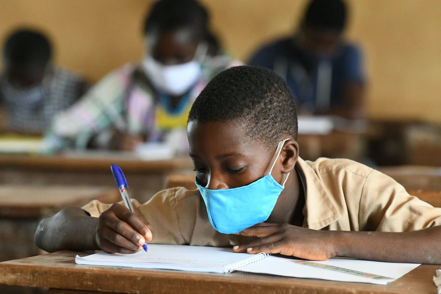 Students attending classes at the Primary school of San Pedro, in the South West of Côte d'Ivoire.   Due to COVID-19, the schools were closed for several weeks. Today classes started, with the necessary measures. Children wear masks, wash their hands regularly and keep a social distance.  For every child, education.