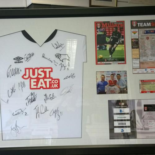 Signed Derby County shirt and related items from a sponsored match.Mount fitted flat to the shirt