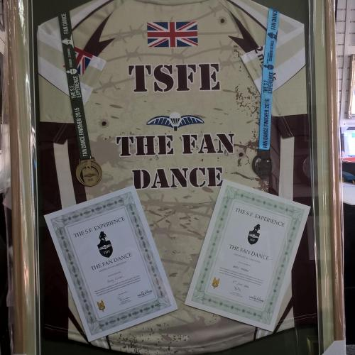 'Fan Dance' shirt and medals