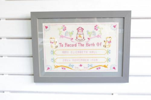 X-stich birth announcement.