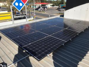 solar panel installation on store's roof.