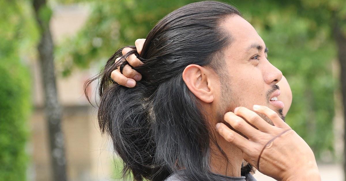 Gathering hair for the man bun