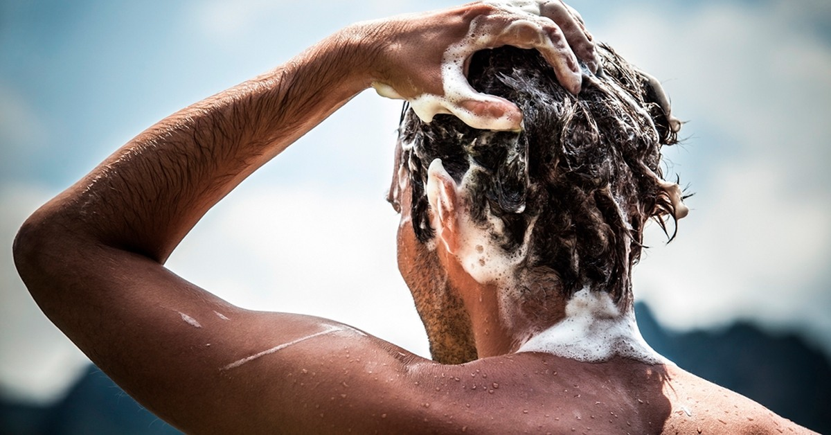 Man shampooing