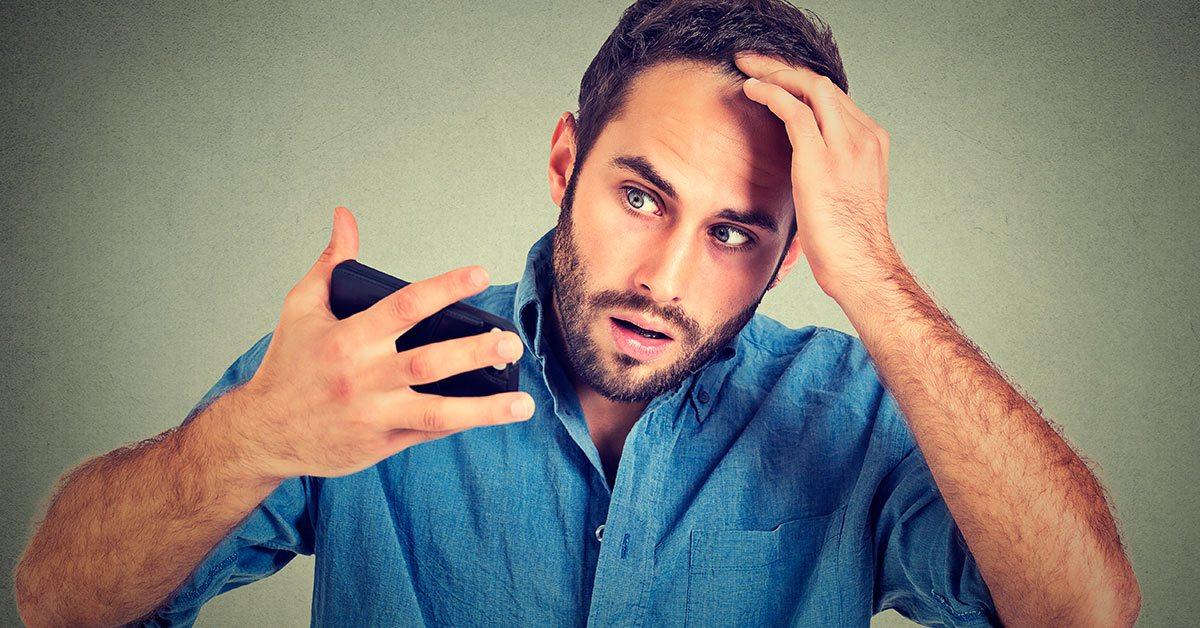 Man discovering receding hair