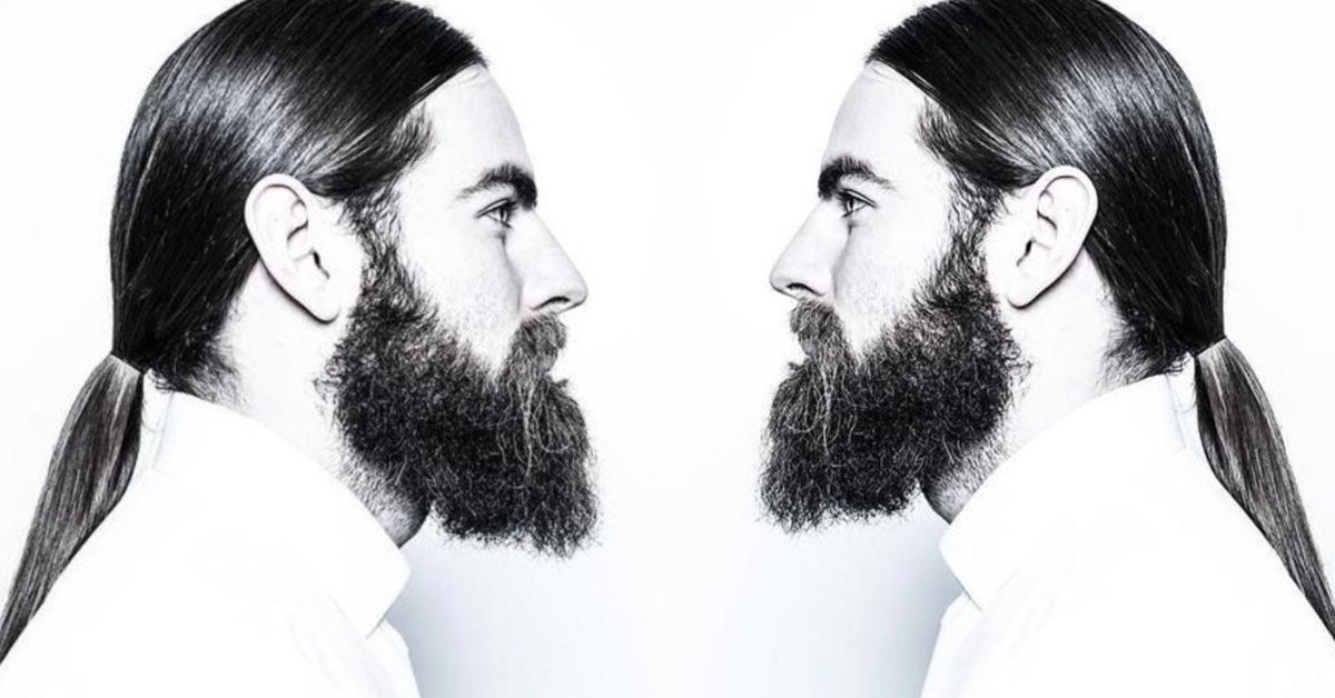 Man with a sleek low ponytail