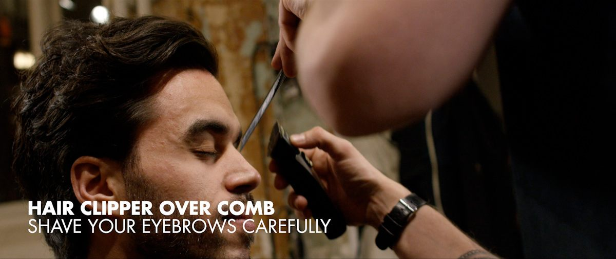 Styling the eyebrows carefully with a hair clipper over comb