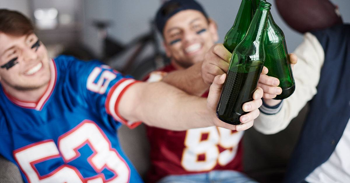 Friends cheering ind beer
