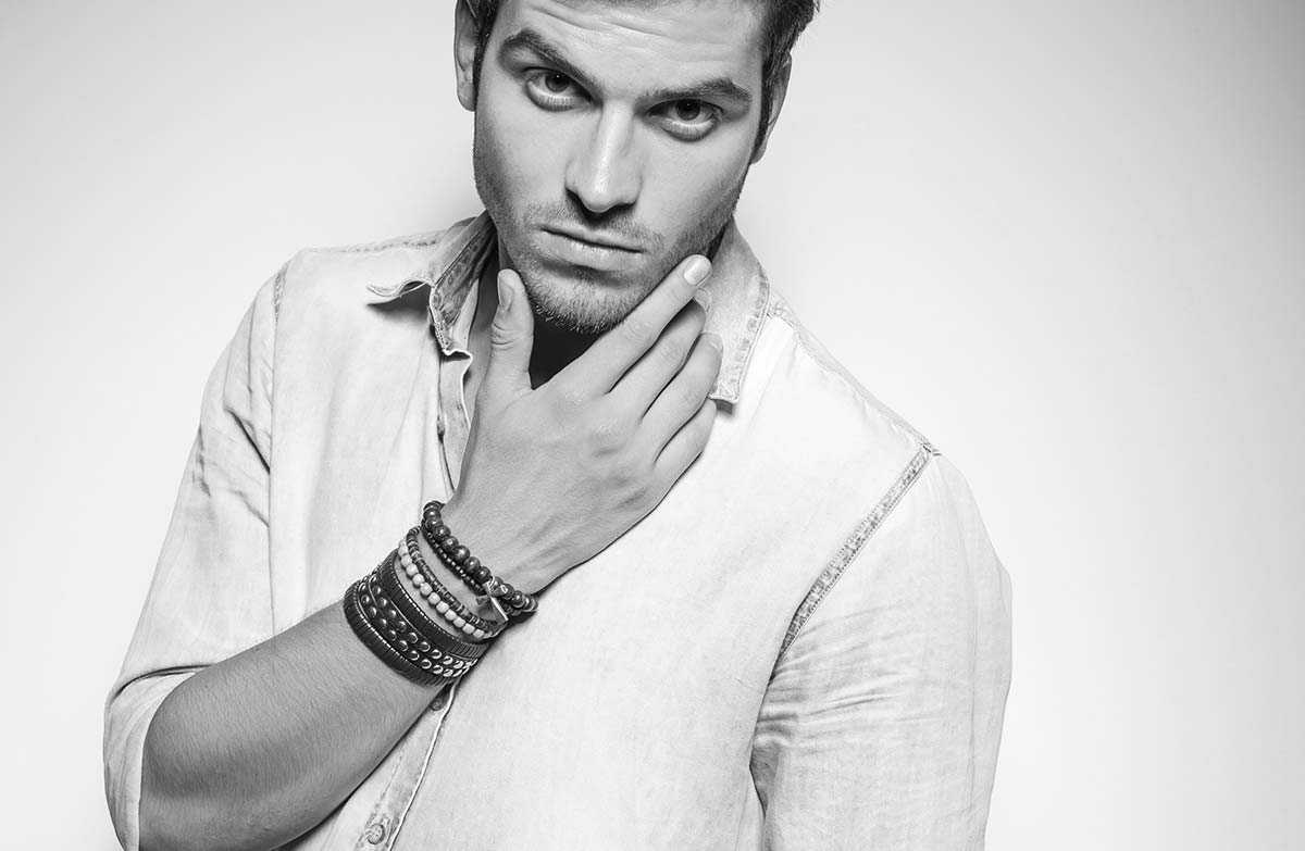 Man with beaded bracelet