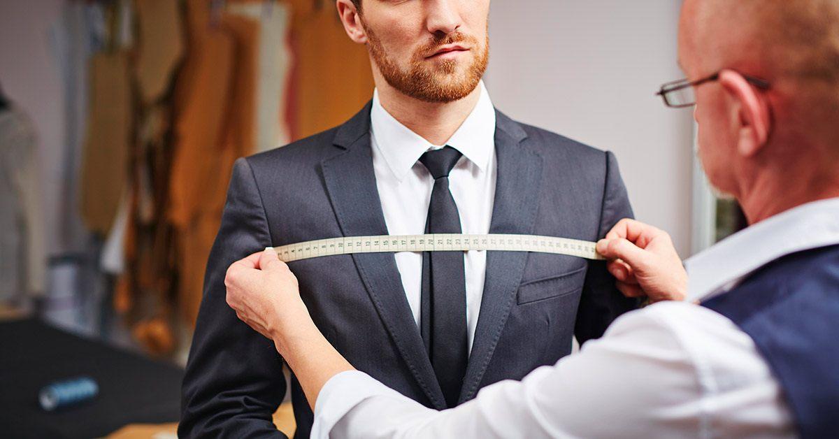 Tailor measuring tuxedo