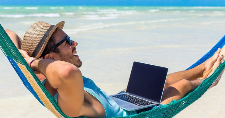 How to protect your hair from sun man in hammock with computer