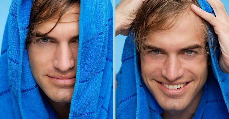 Man drying his hair with blue towel