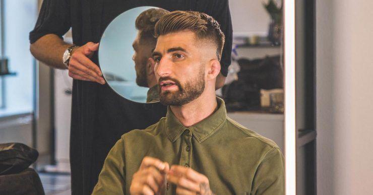 Checking haircut in a mirror
