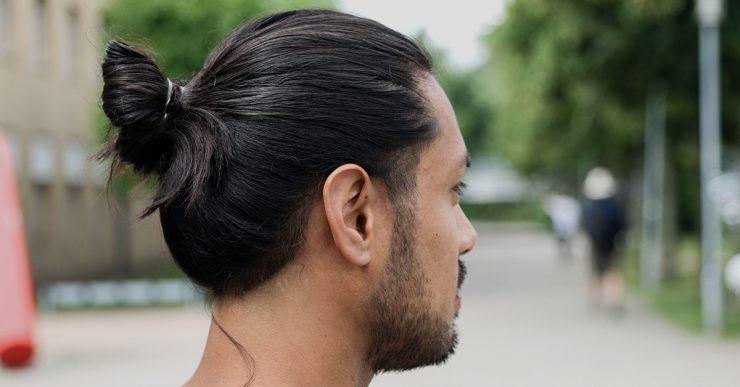 Perfect man bun in long hair